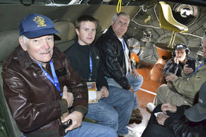 photo - Albert Wheeler, left, prepares to embark on a flight in a B-29 Superfortress at Wiley Post Airport in Oklahoma City on Saturday. The 88-year-old World War II veteran attributes the B-29s that dropped atomic bombs in Japan in 1945 with saving his life. &lt;strong&gt;Zeke Campfield - Zeke Campfield&lt;/strong&gt;