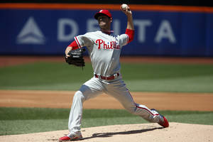 Photo - Philadelphia Phillies' Cole Hamels delivers a pitch during the first inning of a baseball game against the New York Mets, Sunday, May 11, 2014, in New York. (AP Photo/Jason DeCrow)