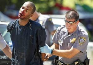 photo - Oklahoma City police take a suspect into custody after a brief chase near NW 10th and Doris drive in Oklahoma City, Oklahoma , Wednesday June 29, 2011. The suspect received bites from a K-9 unit. Photo by Steve Gooch ORG XMIT: KOD