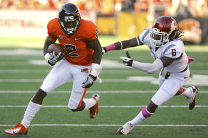 Photo -   Oregon State's Markus Wheaton runs against Washington State's Damante Horton (6) during the first half of an NCAA college football game in Corvallis, Ore., Saturday, Oct 6, 2012. (AP Photo/Greg Wahl-Stephens)