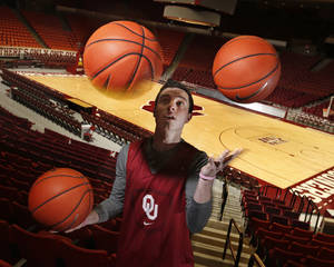 Photo - University of Oklahoma Sooner (OU) guard James Fraschilla shown here at The Lloyd Noble Center on Tuesday, Jan. 21, 2014  in Norman, Okla. Is a trick shot wizard. Photo by Steve Sisney, The Oklahoman