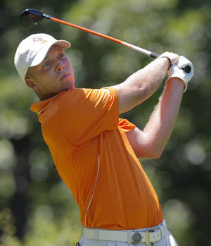 photo - COLLEGE GOLF / NCAA GOLF TOURNAMENT: OSU's Talor Gooch hits a tee shot on No. 9 during the team match semifinals of the NCAA Division I Men's Golf Championship at Karsten Creek in Stillwater, Okla., Saturday, June 4, 2011.  Gooch won his match over Olle Bengtsson of Augusta State. Oklahoma State University lost the match play semifinal to Augusta State. Photo by Nate Billings, The Oklahoman ORG XMIT: KOD