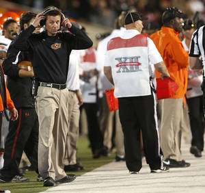 Photo - Oklahoma State coach Mike Gundy watches as his team competes against Texas Tech during their NCAA college football game in Lubbock, Texas, Saturday, Nov. 2, 2013. (AP Photo/Lubbock Avalanche-Journal,Stephen Spillman)