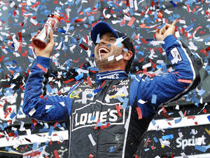 Photo - Jimmie Johnson celebrates after winning the Daytona 500 NASCAR Sprint Cup Series auto race, Sunday, Feb. 24, 2013, at Daytona International Speedway in Daytona Beach, Fla. (AP Photo/Terry Renna)