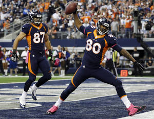 Photo - Denver Broncos tight end Julius Thomas (80) celebrates his touchdown against the Dallas Cowboys during the first quarter of an NFL football game Sunday, Oct. 6, 2013, in Arlington, Texas. Eric Decker (87) joins in. (AP Photo/Tony Gutierrez)