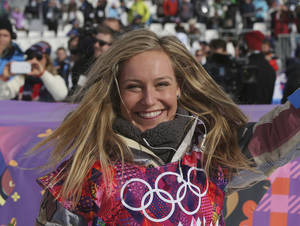 Photo - Jamie Anderson of the United States celebrates after winning the women's snowboard slopestyle final at the 2014 Winter Olympics, Sunday, Feb. 9, 2014, in Krasnaya Polyana, Russia. (AP Photo/Sergei Grits)