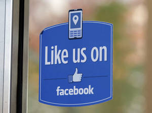 "photo - A sign with Facebook's ""Like"" logo is posted at Facebook headquarters near the office for the company's User Operations Safety Team in Menlo Park, Calif. AP Photo"