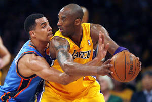 photo - LOS ANGELES LAKERS: Oklahoma City&#039;s Thabo Sefolosha (2) defends against Los Angeles&#039; Kobe Bryant (24) during Game 3 in the second round of the NBA basketball playoffs between the L.A. Lakers and the Oklahoma City Thunder at the Staples Center in Los Angeles, Friday, May 18, 2012. Photo by Nate Billings, The Oklahoman