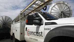 Photo - In this Thursday, April 25, 2013, photo, a Comcast truck is parked in Berlin, Vt. Comcast Corp. reports quarterly financial results before the market opens on Wednesday, May 1, 2013.  (AP Photo/Toby Talbot)