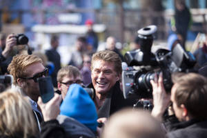 "Photo - US actor David Hasselhoff, center, arrives for a protest against the removal of a section of the East Side Gallery, a historic part of former Berlin Wall, in Berlin, Sunday, March 17, 2013. Hasselhoff is fondly remembered by many Germans for releasing a song called ""Looking for Freedom"" shortly before the fall of the Wall in 1989. (AP Photo/Markus Schreiber)"
