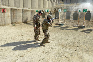 "Photo - Air Force Tech. Sgt. Steven Ely shouts orders at an airman March 5 during an ""active shooter"" scenario on Bagram Air Field, Afghanistan.  (U.S. Air Force photo/Senior Airman Chris Willis) <strong>Christopher V. Willis</strong>"