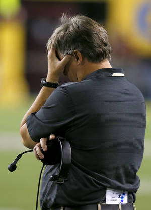 Photo - Colorado head coach Mike MacIntyre puts his hand to his head in disgust during the second half of an NCAA college football game against Arizona State on Saturday Oct. 12, 2013, in Tempe, Ariz.  Arizona State defeated Colorado 54-13. (AP Photo/Ross D. Franklin)