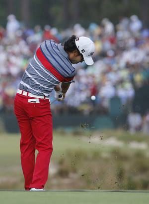 Photo - Kevin Na hits his tee shot on the 17th hole during the first round of the U.S. Open golf tournament in Pinehurst, N.C., Thursday, June 12, 2014. (AP Photo/Matt York)