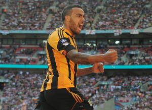 Photo - Hull City's Tom Huddlestone celebrates after scoring against Sheffield United during their English FA Cup semifinal soccer match between Hull City and Sheffield United at Wembley Stadium, London, England, Sunday, April 13, 2014. (AP Photo/Rui Vieira)