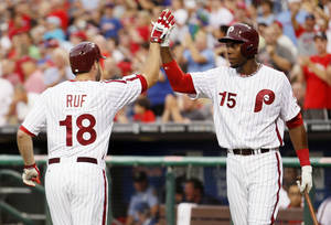 Photo - Philadelphia Phillies' Darin Ruf (18) celebrates his solo home run with John Mayberry during the second inning of a baseball game with the Arizona Diamondbacks, Friday,  Aug. 23, 2013, in Philadelphia. (AP Photo/Tom Mihalek)