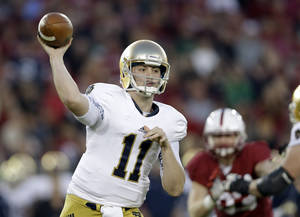 Photo - Notre Dame quarterback Tommy Rees throws against Stanford during the first half of an NCAA college football game on Saturday, Nov. 30, 2013, in Stanford, Calif. (AP Photo/Marcio Jose Sanchez)