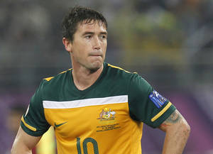 Photo - FILE - In this Jan. 29, 2011 file photo, Australia's player Harry Kewell reacts during the AFC Asian Cup final soccer match between Japan and Australia, in Doha, Qatar. Former Leeds United and Liverpool midfielder Kewell says he will retire from football at the end of the A-League season, giving up his goal of appearing at a third World Cup. Kewell on Wednesday, March 26, 2014 said he will play his last professional match on April 12 when he captains the Melbourne Heart against Western Sydney Wanderers. (AP Photo/Hassan Ammar, File)