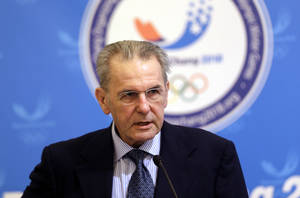 Photo - International Olympic Committee (IOC) President Jacques Rogge speaks during a signing ceremony for a marketing plan agreement with Pyeongchang Organizing Committee for the 2018 Olympic and Paralympic Winter Games President Kim Jin-sun, unseen, in Seoul, South Korea, Wednesday, Jan. 30, 2013. South Korea's eastern city Pyeongchang is the host city for the 2018 Winter Olympics. (AP Photo/Lee Jin-man)