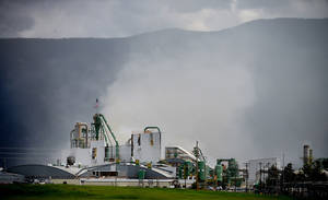 Photo - An explosion and fire hit the Plum Creek Timber Co. Medium-Density Fiberboard plant in Columbia Falls, Montana on Tuesday, June 10, 2014. (AP Photo/Daily Inter Lake, Brenda Ahearn)