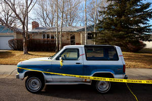 photo - Crime scene tape surrounds he home of Casper College professors Jim Krumm and Heidi Arnold on Saturday, Dec. 1, 2012 in Casper, Wyo. The couple were killed by Krumm&#039;s 25-year-old son Chris Krumm on Friday morning. Arnold died from knife wounds on the street in front of the house, after which Chris Krumm killed his father and himself in a Casper College classroom. (AP Photo/The Casper Star-Tribune, Alan Rogers) MANDATORY CREDIT; TRIB.COM