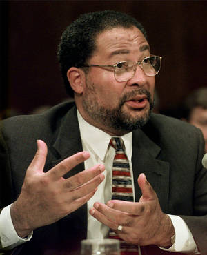 Photo - Time Warner Inc. President Richard Parsons testifies on Capitol Hill Tuesday, July 7, 1998.  British music company EMI Group PLC and America's Time Warner Inc. announced today they would merge their music businesses and EMI chairman Eric Nicoli and Time Warner president Richard Parsons are to be co-chairmen of the merged company.(AP Photo/Joe Marquette)