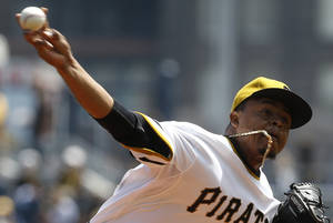 Photo - Pittsburgh Pirates starting pitcher Edinson Volquez throws against the Toronto Blue Jays in the first inning of a baseball game on Sunday, May 4, 2014, in Pittsburgh. (AP Photo/Keith Srakocic)