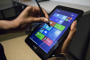 Photo - This April 24, 2014 shows the ASUS VivoTab Note 8 tablet computer, in Atlanta. The Note 8 runs a full version of Microsoft's Windows 8 operating system and comes with a Wacom stylus pen for use with the screen that has 1024 levels of pressure sensitivity. (AP Photo/Ron Harris)