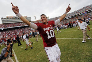 Photo - OU's Blake Bell (10) celebrates after the Red River Rivalry college football game between the University of Oklahoma (OU) and the University of Texas (UT) at the Cotton Bowl in Dallas, Saturday, Oct. 13, 2012. OU won, 63-21. Photo by Nate Billings, The Oklahoman