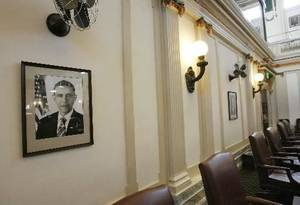 Photo - A  portrait of president, Barack  Obama, hangs on a wall in the House chamber at the  Oklahoma state Capitol.  By Jim Beckel