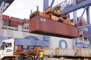 Photo - A container is loaded onto a ship from China at Massport's Conley Terminal in the port of Boston, Friday, July 13, 2012. The Commerce Department reports Thursday March 13, 2014 how much companies adjusted their stockpiles in January. (AP Photo/Stephan Savoia)