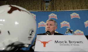 Photo - Texas coach Mack Brown listens to a question during a Valero Alamo Bowl NCAA college football news conference, Thursday,  Dec. 12, 2013, in San Antonio. Texas and Oregon will play Dec. 30. (AP Photo/Eric Gay)