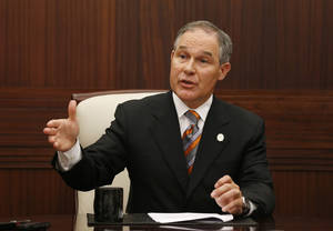 Photo - Oklahoma Attorney General Scott Pruitt gestures as he answers a question during a news conference in Oklahoma City on July 16, 2013. AP Photo/Sue Ogrocki <strong>Sue Ogrocki</strong>