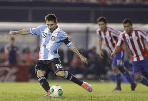 Photo - Argentina's Lionel Messi scores a penalty against Paraguay during a World Cup qualifying soccer game in Asuncion, Paraguay, Tuesday, Sept. 10, 2013. (AP Photo/Cesar Olmedo)