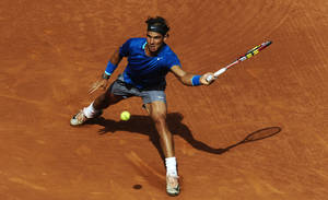 Photo - Rafael Nadal returns the ball to Nicolas Almagro during the Barcelona open tennis in Barcelona, Spain, Friday, April 25, 2014. (AP Photo/Manu Fernandez)