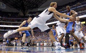 photo - Dirk Nowitzki (41) of Dallas  and Oklahoma City's Serge Ibaka (9) go for the ball during game 2 of the Western Conference Finals in the NBA basketball playoffs between the Dallas Mavericks and the Oklahoma City Thunder at American Airlines Center in Dallas, Thursday, May 19, 2011. Photo by Bryan Terry, The Oklahoman