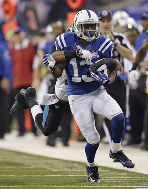 Photo - Indianapolis Colts' T.Y. Hilton (13) is tackled by Jacksonville Jaguars' Josh Evans during the second half of an NFL football game on Sunday, Dec. 29, 2013, in Indianapolis. (AP Photo/AJ Mast)