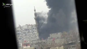 photo - This image taken from video obtained from Ugarit News, which has been authenticated based on its contents and other AP reporting, shows smoke and fire billowing from an explosion in Damascus, Syria, Wednesday, Feb. 6, 2013. Heavy fighting erupted in Damascus Wednesday as government forces tried to hold back a new rebel effort to push the civil war into the heart of the Syrian capital, activists said.(AP Photo/Ugarit News via AP video)