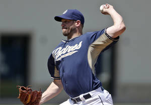 Photo - San Diego Padres starter Eric Stults pitches to the Cleveland Indians in the first inning of the final spring training exhibition baseball game, Saturday, March 29, 2014, in San Diego. Stults threw four innings and allowed one run on one hit.  (AP Photo/Lenny Ignelzi)