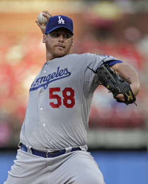 Photo -   Los Angeles Dodgers starting pitcher Chad Billingsley sets to deliver a pitch in the first inning of a baseball game against the St. Louis Cardinals, Monday, July 23, 2012 in St. Louis.(AP Photo/Tom Gannam)