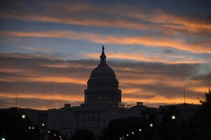Photo - The morning sun illuminates the U.S. Capitol in Washington, Monday, Sept. 30, 2013, as the government teeters on the brink of a partial shutdown at midnight unless Congress can reach an agreement on funding. (AP Photo/J. Scott Applewhite)
