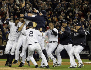 Photo - The New York Yankees celebrate winning the World Series with a 7-3 Game 6 win over the Philadelphia Phillies. AP PHOTO