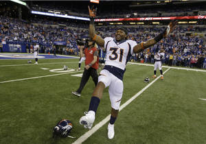 Photo - Denver Broncos' Omar Bolden (31) warms up before an NFL football game against the Indianapolis Colts, Sunday, Oct. 20, 2013, in Indianapolis. (AP Photo/Michael Conroy)