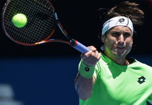 Photo - David Ferrer of Spain plays a shot to Jeremy Chardy of France  during their third round match at the Australian Open tennis championship in Melbourne, Australia, Friday, Jan. 17, 2014.(AP Photo/Aaron Favila)