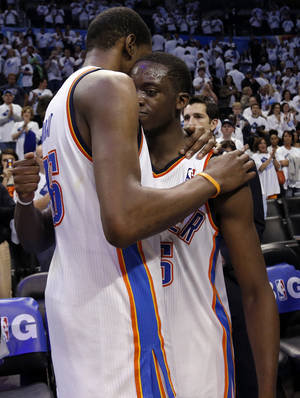 Photo - Oklahoma City's Kevin Durant (35) hugs Reggie Jackson (15) following Game 5 in the second round of the NBA playoffs between the Oklahoma City Thunder and the Memphis Grizzlies at Chesapeake Energy Arena in Oklahoma City, Wednesday, May 15, 2013. Photo by Sarah Phipps, The Oklahoman