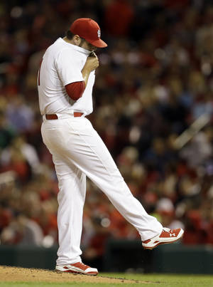 Photo - St. Louis Cardinals starting pitcher Lance Lynn kicks at the dirt after giving up a two-run single to Milwaukee Brewers' Kyle Lohse during the fourth inning of a baseball game Tuesday, April 29, 2014, in St. Louis. (AP Photo/Jeff Roberson)