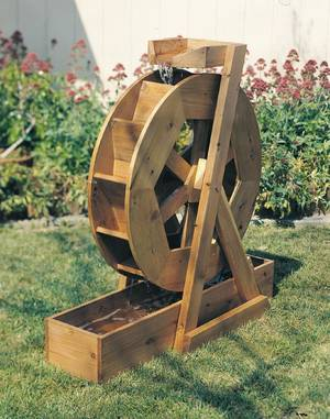 Photo - Enjoy the tranquility of water with this handmade water wheel.  Photo provided