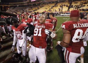 Photo - CELEBRATION: Oklahoma's R.J. Washington (91) celebrates after winning the Insight Bowl college football game between the University of Oklahoma (OU) Sooners and the Iowa Hawkeyes at Sun Devil Stadium in Tempe, Ariz., Friday, Dec. 30, 2011. Photo by Bryan Terry, The Oklahoman