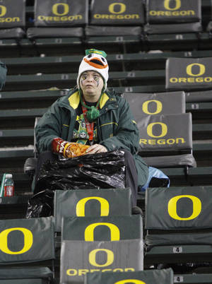 photo -   A lone Oregon fan sits in the stands after Oregon lost their NCAA college football game against Stanford in Eugene, Ore., Saturday, Nov. 17, 2012. Stanford won 17-14 in overtime.(AP Photo/Don Ryan)