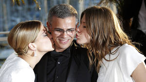 Photo - Actress Lea Seydoux, left, director Abdellatif Kechiche, centre, and Adele Exarchopoulos pose with the Palme d'Or award for the film La Vie D'Adele during a photo call after an awards ceremony at the 66th international film festival, in Cannes, southern France, Sunday, May 26, 2013.  (AP Photo/Lionel Cironneau)