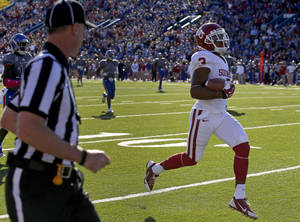 Photo - OU's Sterling Shepard (3) scores a touchdown on a trick play during the college football game between the University of Oklahoma Sooners (OU) and the University of Kansas Jayhawks (KU) at Memorial Stadium in Lawrence, Kan., Saturday, Oct. 19, 2013. Oklahoma won 34-19. Photo by Bryan Terry, The Oklahoman